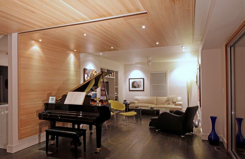 Black grand piano in the interior of a small modern living for Small grand piano