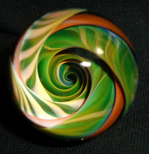 "Contemporary handmade art glass ""vortex"" marble, by James Holt  (JEH Marbles). Photograph cannot capture the amazing depth in this marble!"
