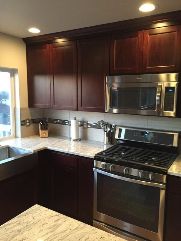 New kitchen with Dark Cherry cabinets, Wine River granite counters ...