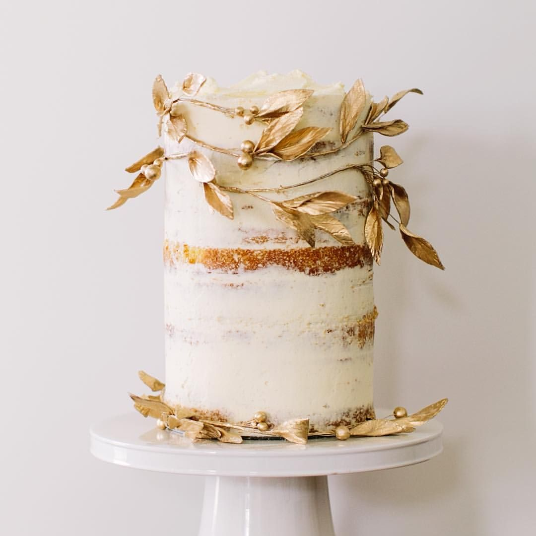 Naked butter cream cake entwined with gold painted sugar