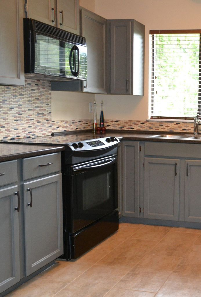 Black appliances and white or gray cabinets how to make for How to paint kitchen cabinets black
