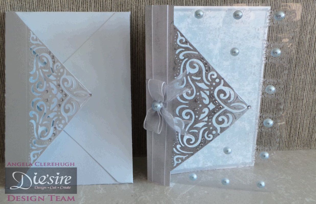 Angela Clerehugh – Create a Card - 5 x 7 Card – Die'sire Create A Card Chantilly – Centura Pearl – Acetate – Distress Ink (Iced Spruce) – Red Tape – Collall Tacky Glue – Sheena Douglass Embossing Folder – Paper from own stash – Gems – Ribbon – Pearl - Eyelets; 5 x 7 Envelope – Die'sire Create A Card Chantilly – Collall Tacky Glue - Blue Card & Paper from own stash - Gems - #crafterscompanion