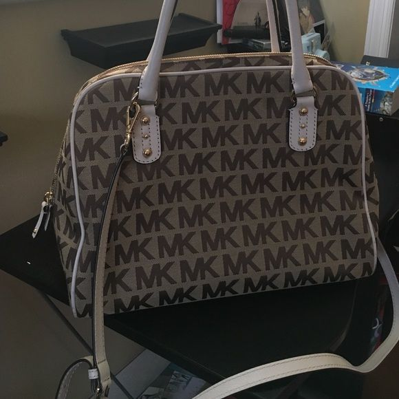 Authentic Michael Kors Neutral/Tan and Cream Bag Real Michael Kors Bag. Great condition other than small dark stain on the bottom inside the bag. (Travel perfume spilled) . Has a long satchel to hang over shoulder. Great addition to your closet You can list your offers. Michael Kors Bags Satchels