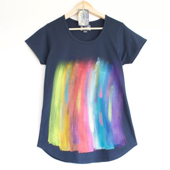 RAINBOW T SHIRT. Painted rainbow on dark / navy blue 100% cotton t-shirt .  For lovers of colour, rainbow, nature, paint brush stroke pattern, festivals, symbols etc....  Women's t shirt has been hand painted with non toxic, water-based fabric paint for this cool, rainbow-like print. Colours are permanent, soft & it can be washed and treated like any other t shirt, although we do recommend turning it inside out before washing. Our designs come as a one of a kind as all painting is done by…