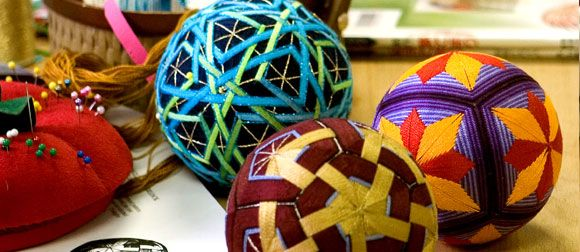 """Temari, Japanese thread balls. Link goes to """"how to"""" books on this subject in the Jacksonville (FL) Public Library."""