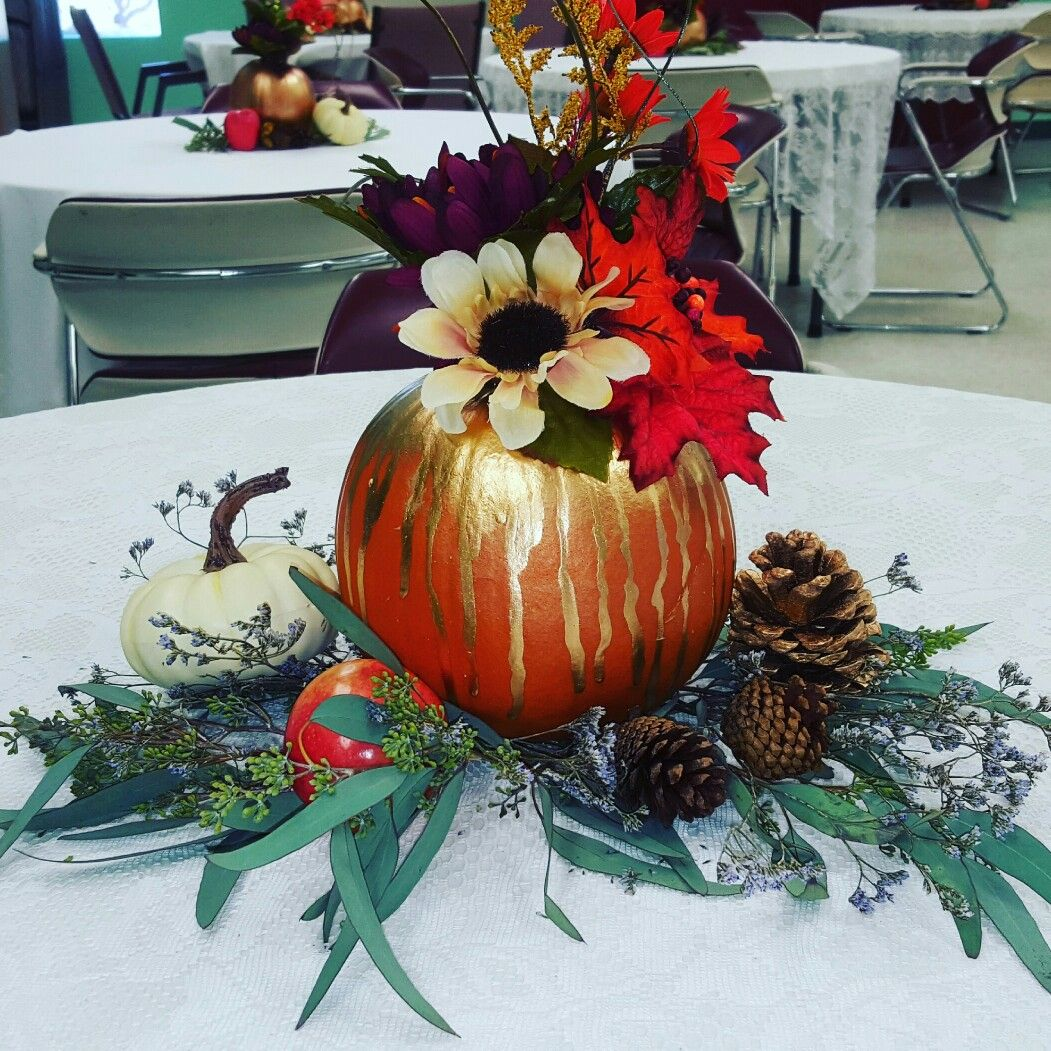 Fall pumpkin centerpiece. Painted pumpkin with silk flowers and dried flowers.