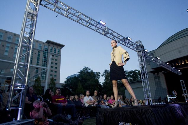 A model from the Alfa Fem Collection, designed by Sophie St. Claire, walks down the runway during Fashion Night Out at the Gallivan Center in Salt Lake City on Sept. 14, 2012. (Kim Raff | The Salt Lake Tribune)