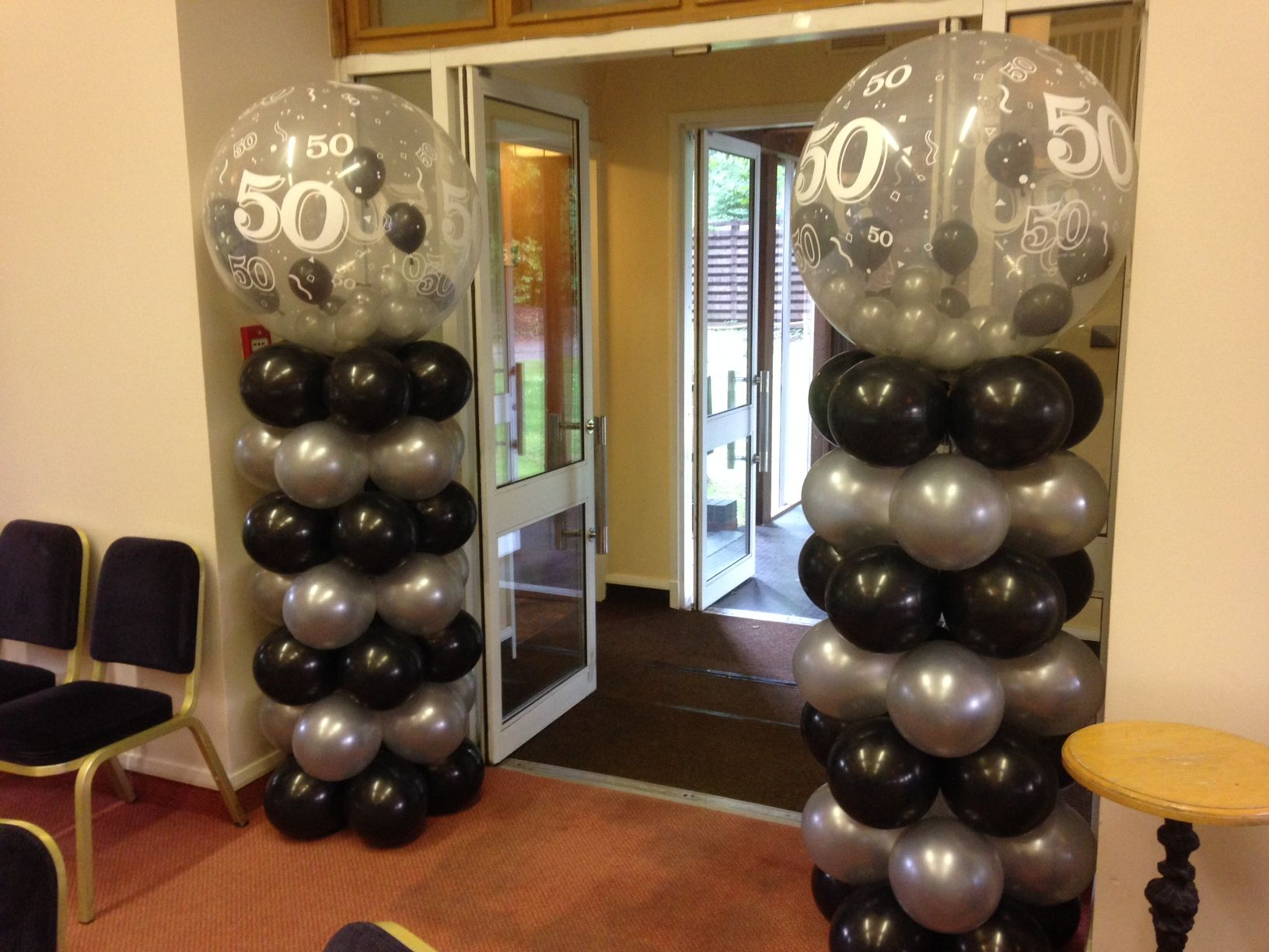 Entrance columns with 50th gumball balloons on top (With ...