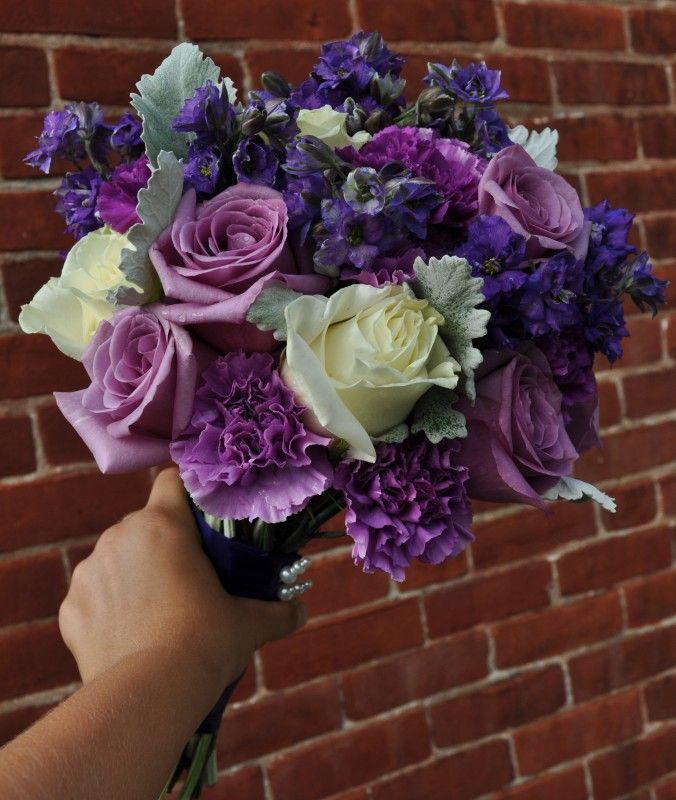 Side View Of Bride S Purple August Wedding Bouquet
