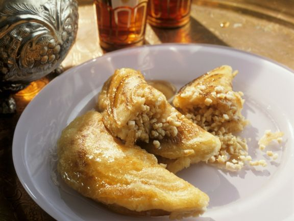 Orientalische Pfannkuchen mit süßer Füllung ist ein Rezept mit frischen Zutaten aus der Kategorie Pfannkuchen. Probieren Sie dieses und weitere Rezepte von EAT SMARTER!