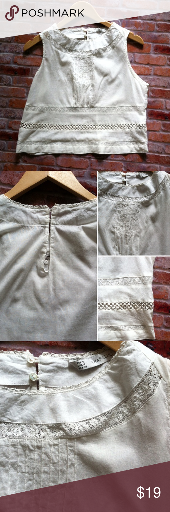 """Zara Trafaluc boho white cropped top 100% lightweight cotton top. Lace border around the neck and cutout lace stripes at the hem. Lightly pleated bust. Key at nape with two buttons. Perfect topper for a maxi skirt or throw on with cutoffs and sandals and head to the beach. 19""""L. 19"""" across bust laying flat. Size Medium. Zara Tops"""