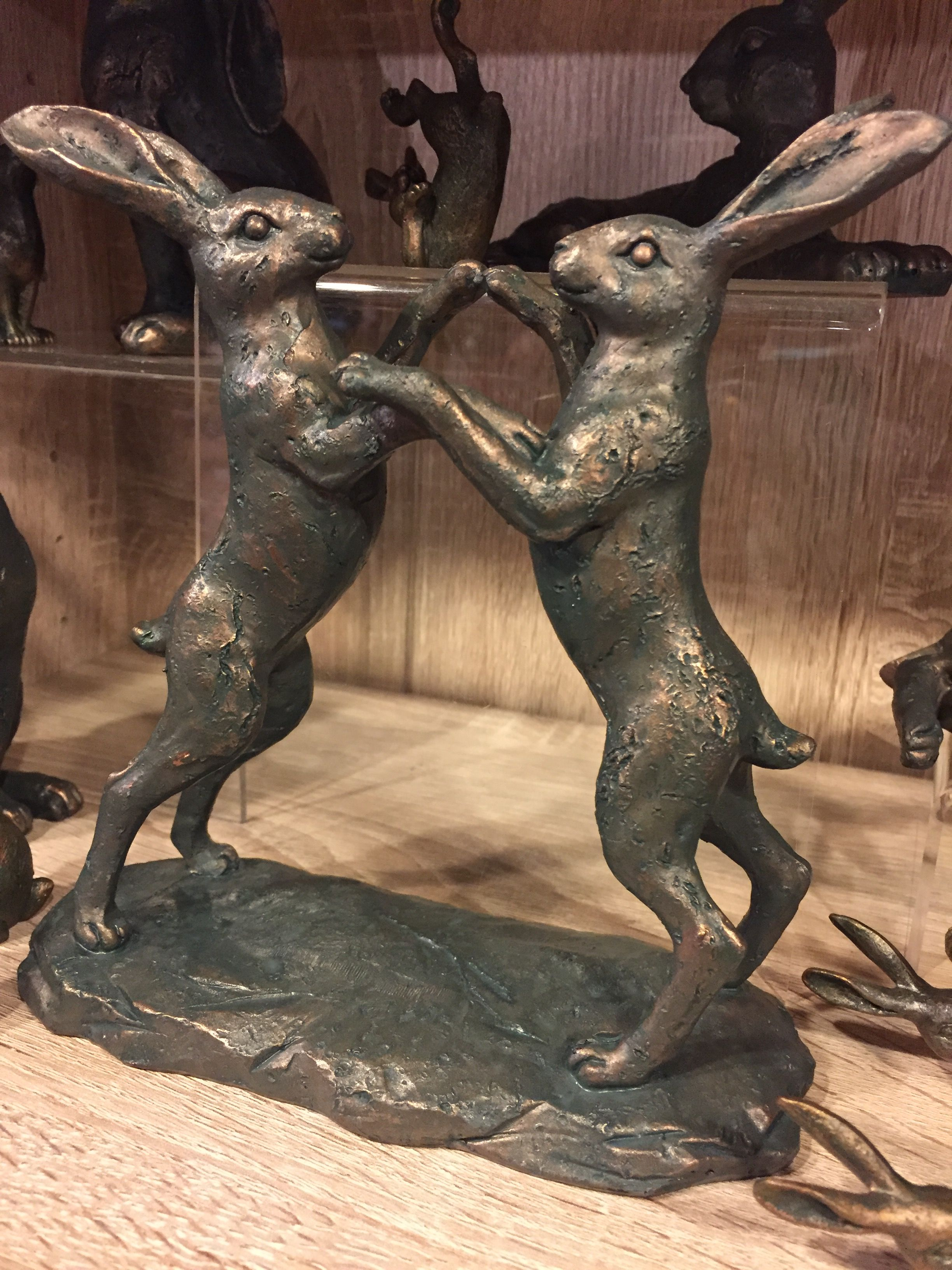 March hares Lion sculpture, Pet birds, Pottery animals