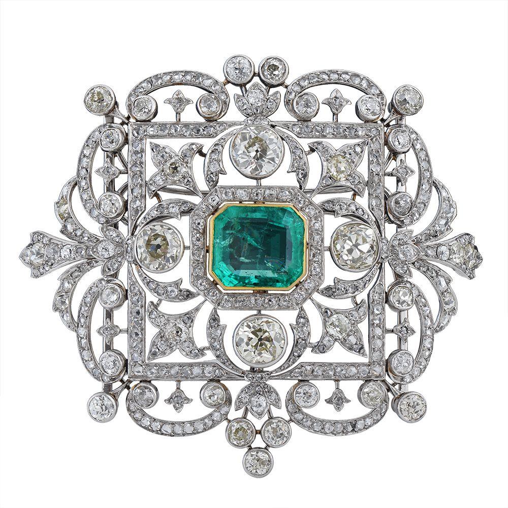 An impressive platinum emerald u diamond broochpendant cased by