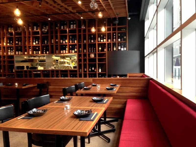 Japanese restaurant interior design with red sofa on