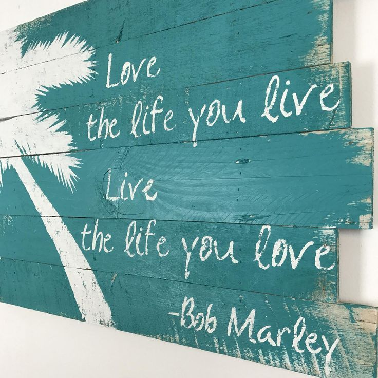 """Beach Decor White Palm Tree and Love the Life You Live, Live the Life you Love on Teal background.  Embrace the beach mind set. Whether it is a declaration of what you think or a reminder to think this way, this wall hanging brings a coastal vibe to your home. And, who says it better than Bob Marley? Love the life you live, live the life you love. The size is roughly 21'L x 32""""W x 2""""D. Please message me if you would like this piece in another color or size. This wall art  is made from reclaimed pallet wood. The years of weather and miles of wear create a rustic look that simply can not be artificially created. Splits, cracks and nail holes build character. This item has already been sold. Your purchase will be a very similar product. Reclaimed wood provides a unique appearance. Each item is a one of a kind. While custom orders will be very similar to the item shown, some differences may be noticeable.  This item is shipped complete and with necessary mounting hardware. Check out the rest of the shop! http://www.etsy.com/shop/WoodburyCreek?ref=search_shop_redirect"""