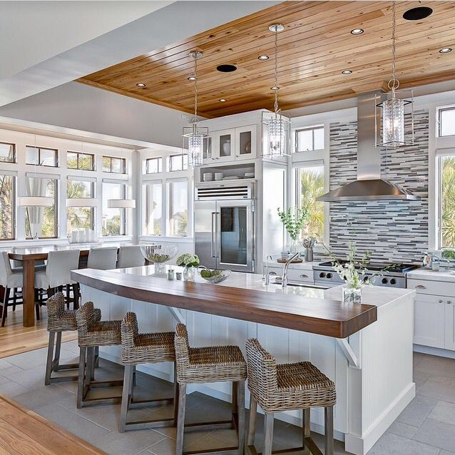 Wood Accent On Ledge Of Island Beach House Kitchens
