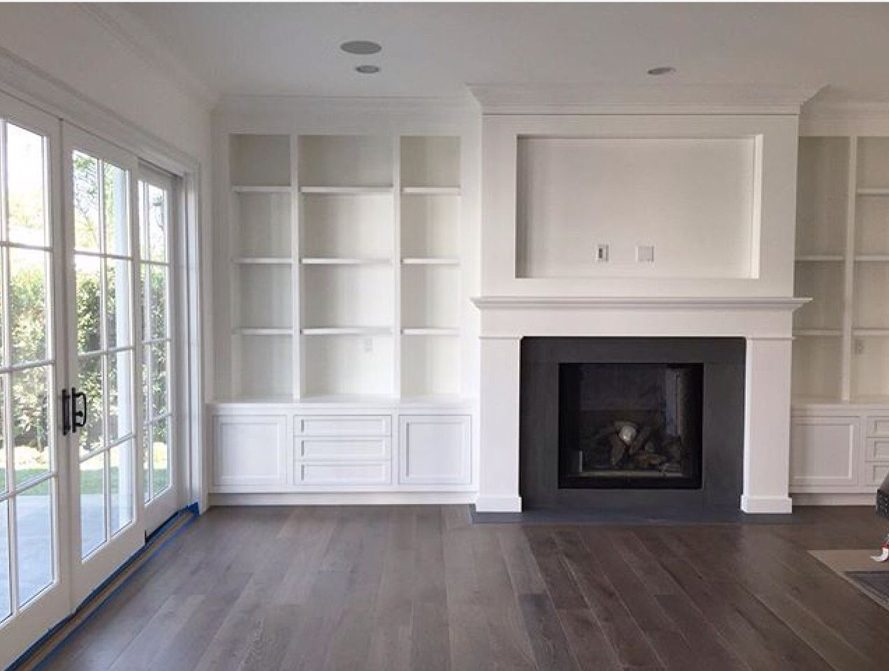 amber interiors built in shelving around fireplace cut out for tv. Black Bedroom Furniture Sets. Home Design Ideas