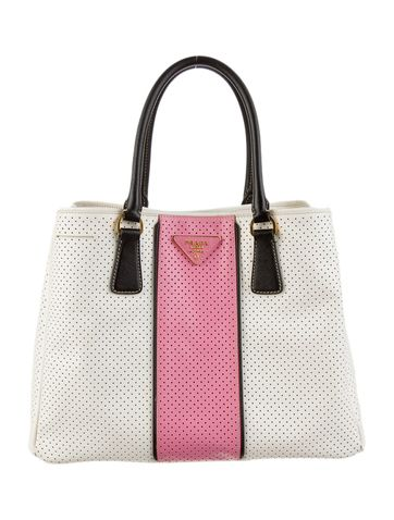 ebcca78ab3e010 50's chic with this Prada Perforated Handle Bag - Luxurydotcom | OMG ...