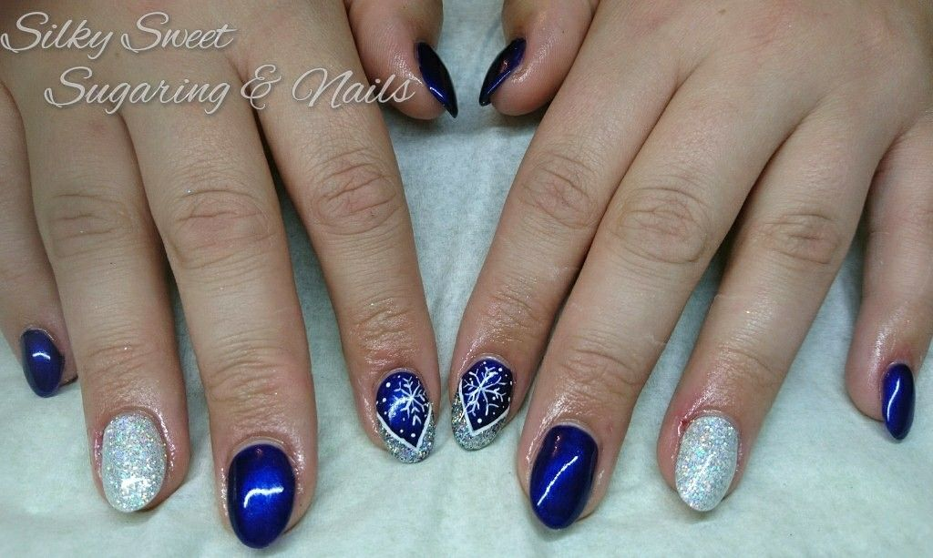 Blue Christmas Nails With Glitter And Snowflakes Christmas Nails Acrylic Nails Blue Christmas Nails