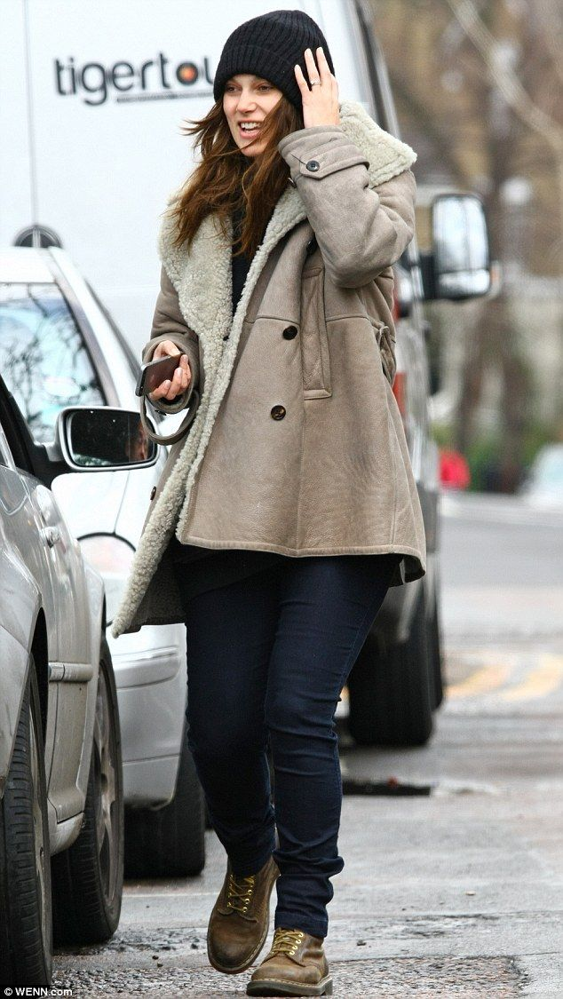 Winter warmer:The 29-year-old actress, who received a of Best Supporting Actress Oscar nod for her role in The Imitation Game, kept her baby bump under wraps as she bundled up against the winter chill in