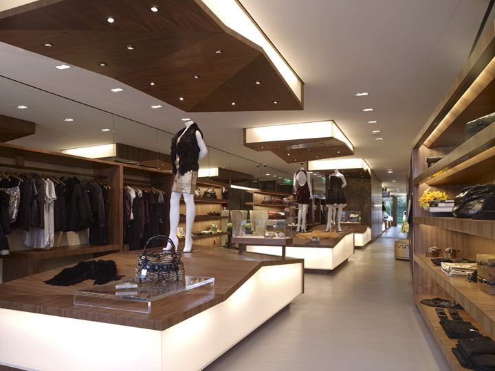 Interesting drop ceiling with lights and side lighting as for Interior designs of boutique shops