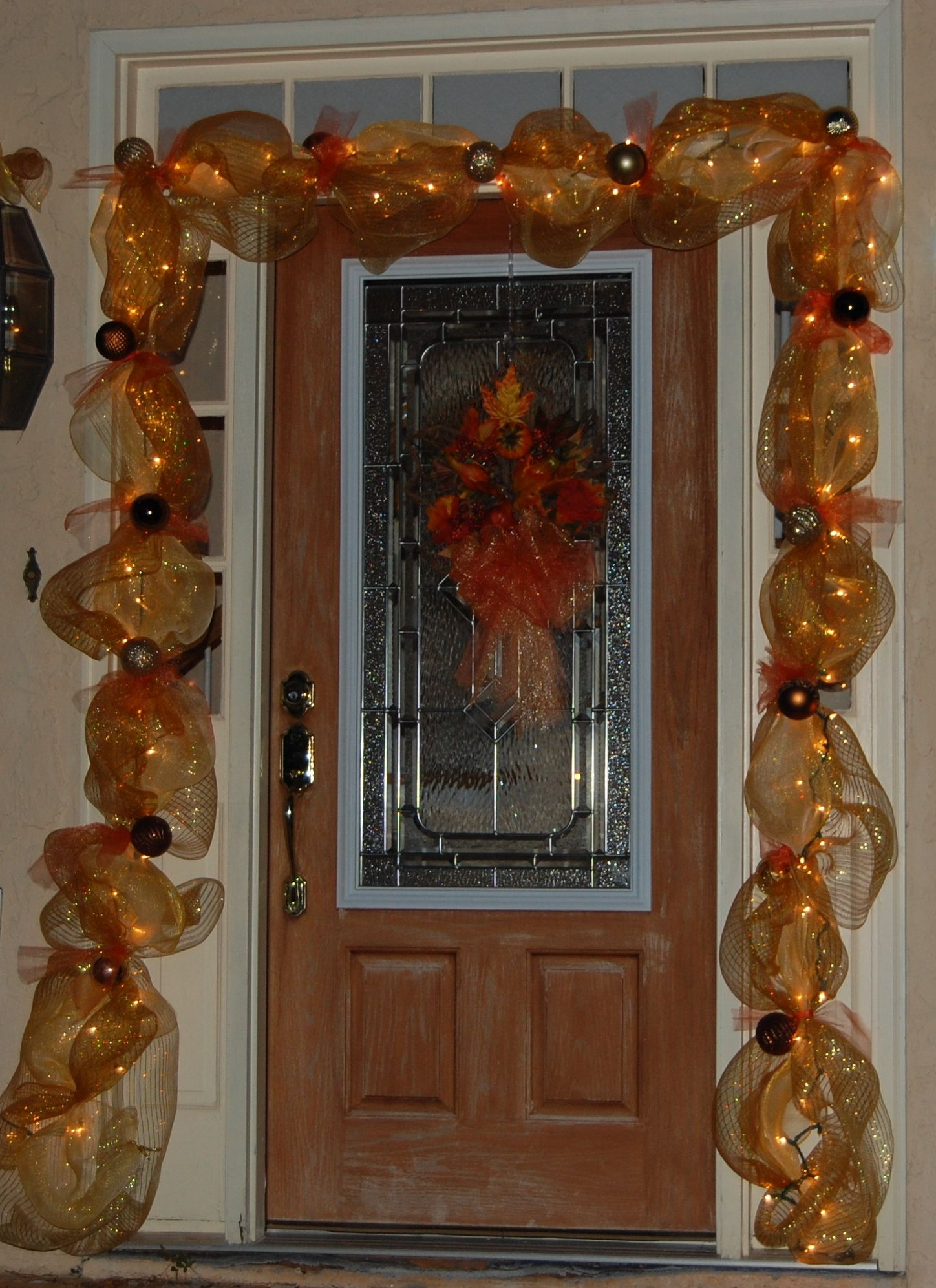 Front door decor. Mesh ribbon with lights in the middle