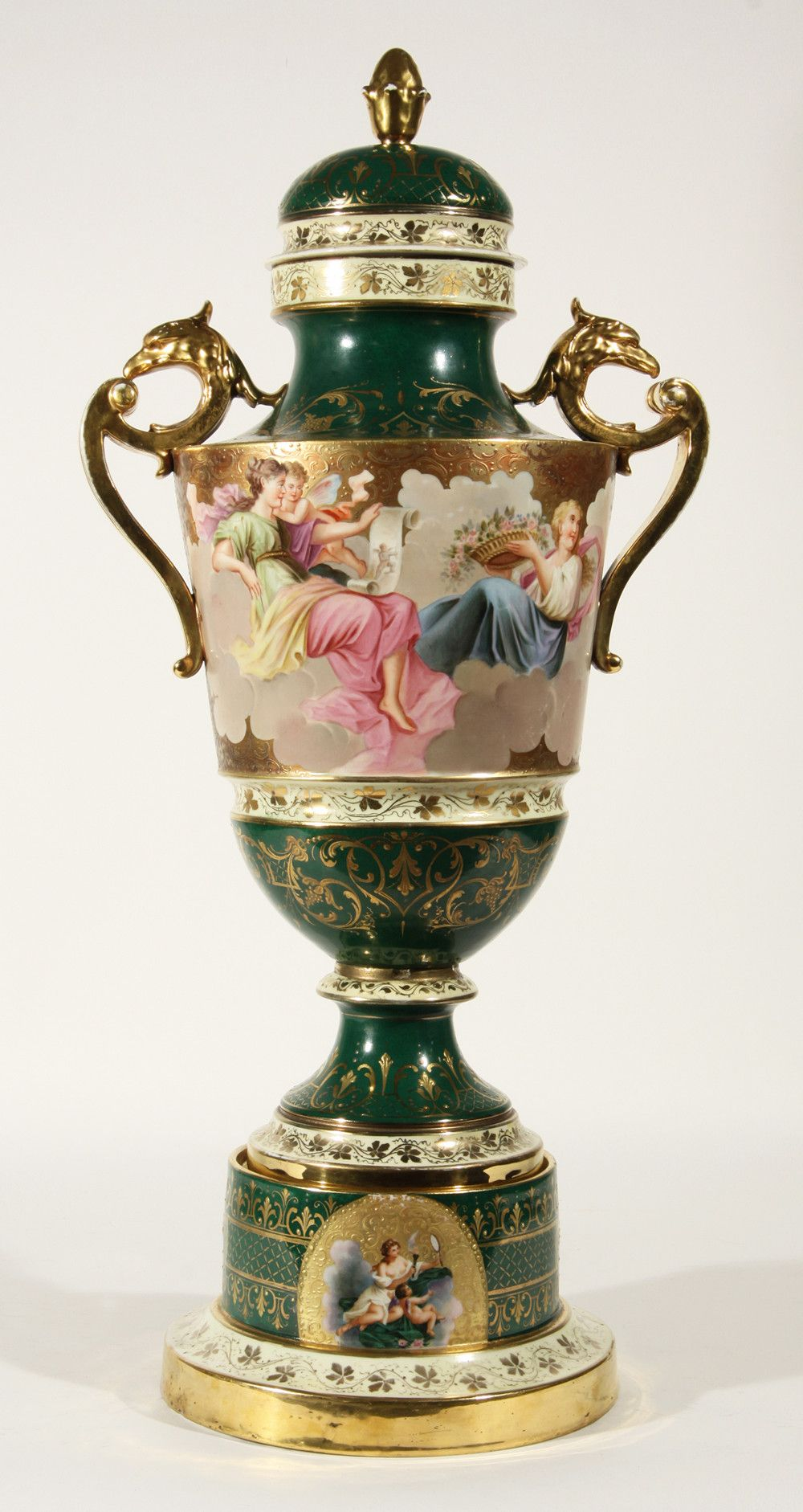 "A ROYAL VIENNA VASE, 19th C., of urn shape, mounted by gilded handles in the shape of griffin heads, the hunter-green body decorated with scrolling gilt patterns with white bands painted in an ivy motif, the central band hand-painted with images of cherubs and maidens resting on clouds, the base marked with a blue beehive mark and signed ""E . I , Austria"""