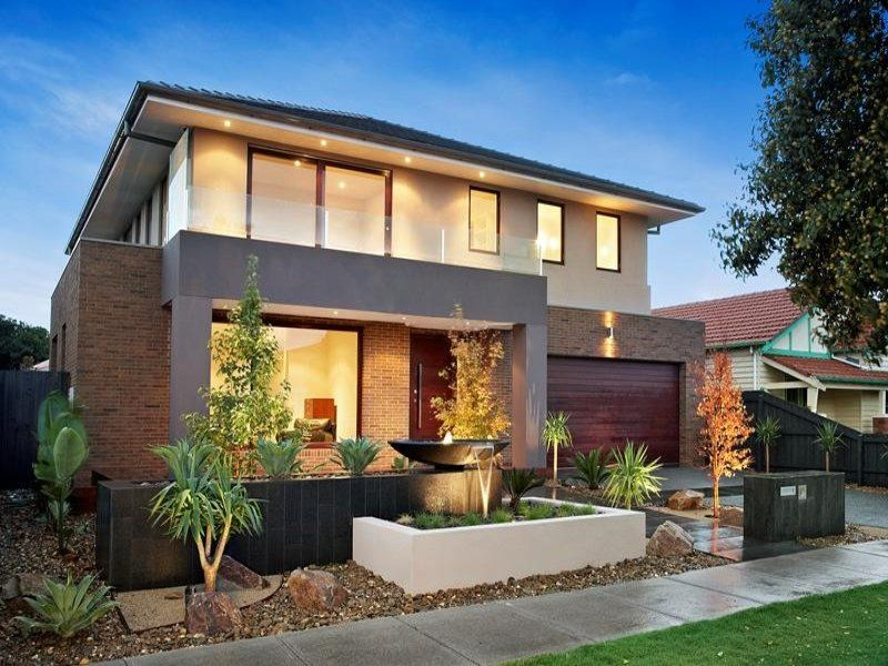 brick modern house exterior with balcony fountain
