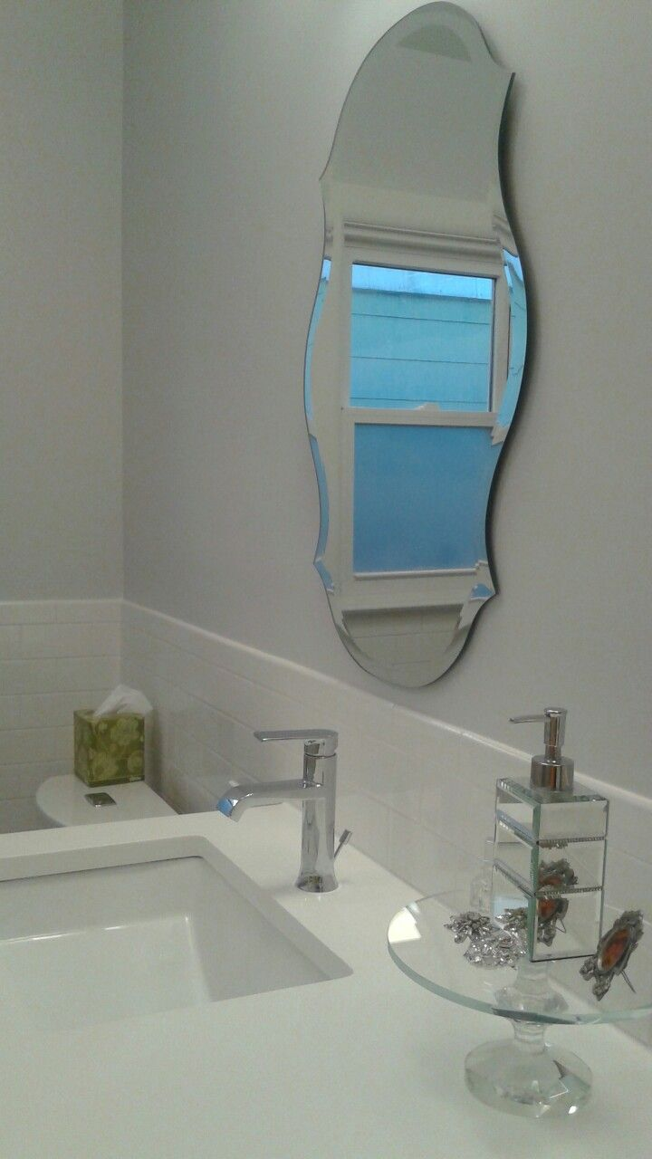 Finally finished our bathroom.  So happy with the results!   Audrey mirror from Ballard Designs.