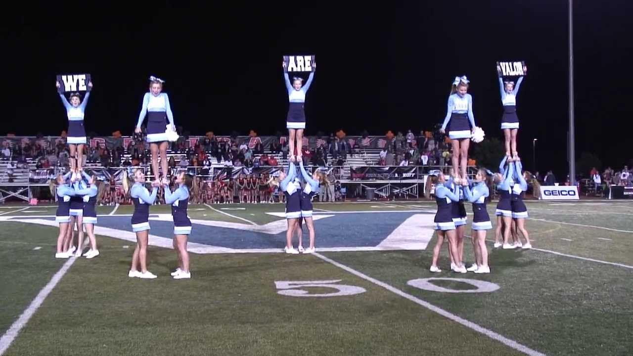 High School Cheerleaders At Halftime At The Football Game Cheerleading Cheers Cheer Routines Cheerleading