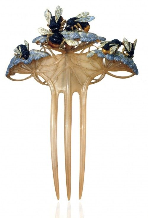 René Lalique Art Nouveau jewellery designer...another hair comb. I like these because I have such long hair and I can do so much with one and my hair not look like it's falling all over. Plus the design is the most important. If it's not right can ruin your entire ensemble.