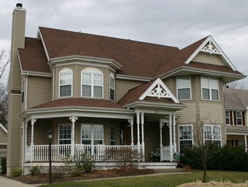 two story house with wrap around porch and a bay window | ... bay