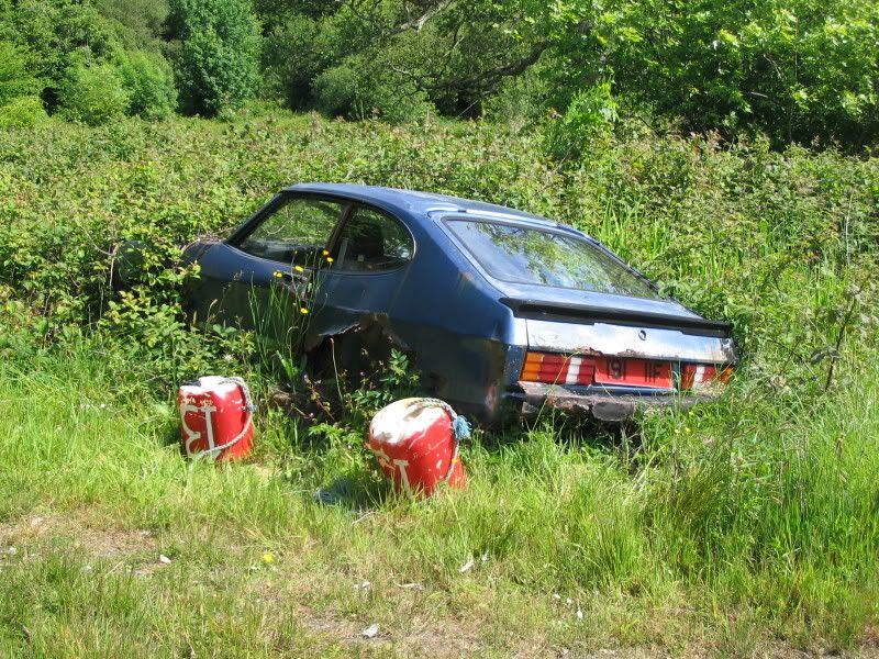 A ford capri in the Irish countryside, bearing an old style Irish ...