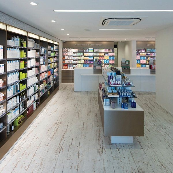 Pharmacie parapharmacie agencement pharmacie design for Agencement bureau design