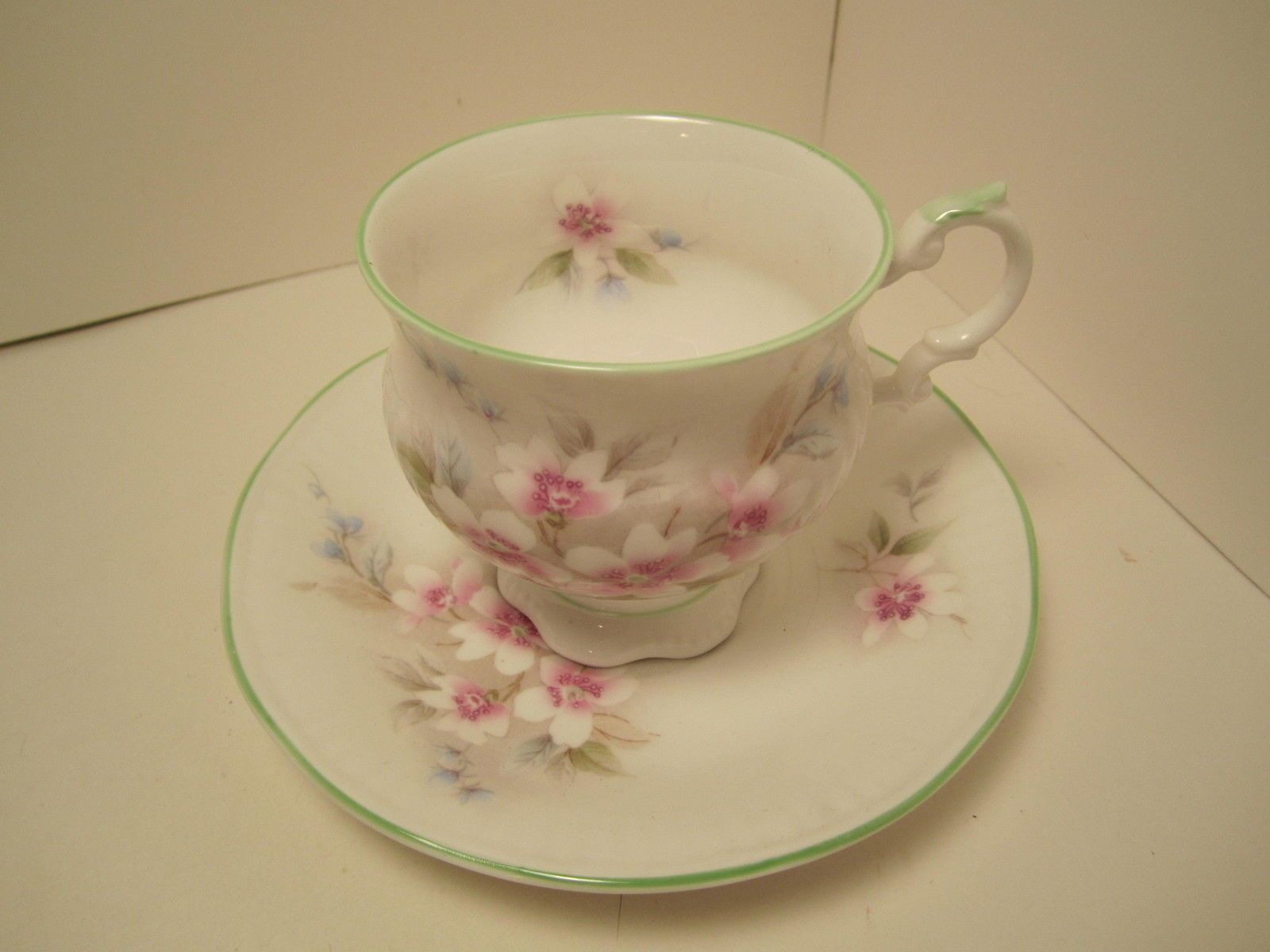 FOR SALE TODAY THIS PRETTY ELIZABETHAN CHINA TEA CUP & SAUCER WHITE WITH PINK FLOWERS AND GREEN TRIM ON CUP SAUCER AND HANLE MADE IN ENGLAND IN GOOD VINTAGE CONDITION NO CHIPS OR CRACKS PLEASE TAKE A LOOK! Posted with eBay Mobile