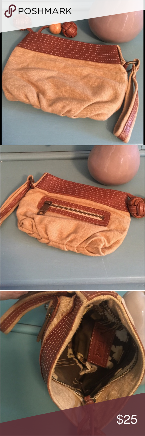 "Fossil Canvas Wristlet GUC Fossil Tan Canvas Wristlet with leather trim around the top with zipper closure.  Small exterior zipper pocket as well as a Zipper pocket on the interior. The leather on one side of the trim as shown in the images is turning up slightly.  Measures 8"" x 5.5"".  Fits an iPhone 6 Plus.   Perfect for any concerts where you don't want to take a large purse or going out downtown.  Just take the few things you do go and your good to go. Fossil Bags Clutches & Wristlets"