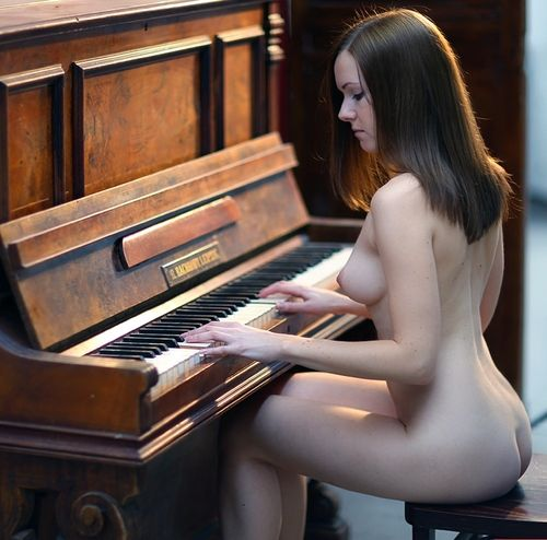 Nudist girl playing piano that