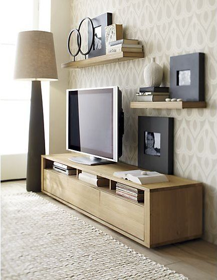 Under 18″ 10 UltraLow TV Consoles is part of Neutral Living Room TV Stand - (Image credit Apartment Therapy) The ideal height for TV viewing is in line with eye level in a seated position (and not above the fireplace)  A lowprofile sofa, as is in vogue in many modern homes, thus begs for a different viewing setup which takes into account the lounger's lower perspective  Here are 10 media