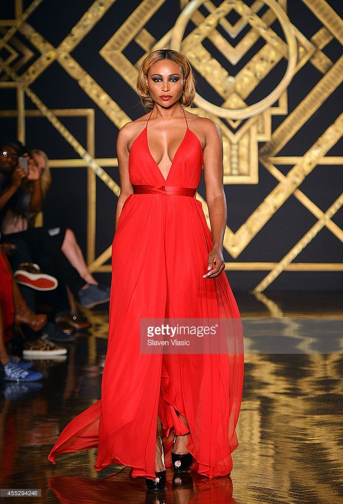 Personality Cynthia Bailey walks the runway at the Kithe Brewster fashion show during...