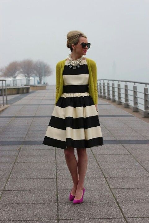 black and white striped dress with colored cardi and statement necklace