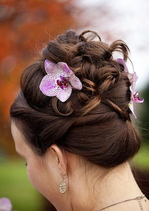 4 Ways That Orchids Can Infuse Your Winter Wedding With Warmth And Style Special Occasion Hairstyles Wedding Wedding Hairstyles