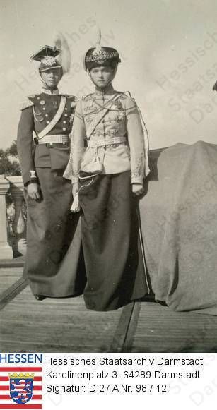 Olga and Tatiana both in uniforms of their regiments