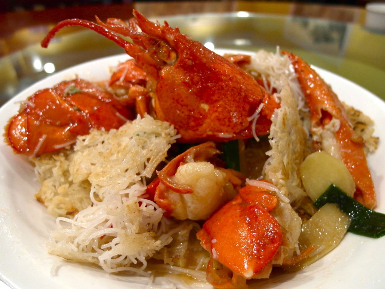 Sauteed lobster with pan-fried thin rice noodles 龍蝦煎米粉. Awesome pairing.