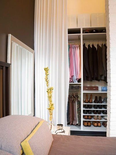 Curtains Are A Simple Solution To A Doorless Closet Problem