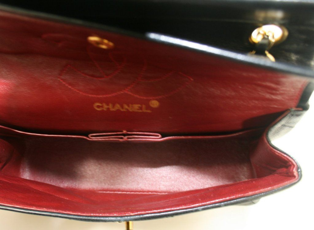 Chanel Black Leather Small Double Flap Classic   From a collection of rare vintage handbags and purses at http://www.1stdibs.com/fashion/accessories/handbags-purses/