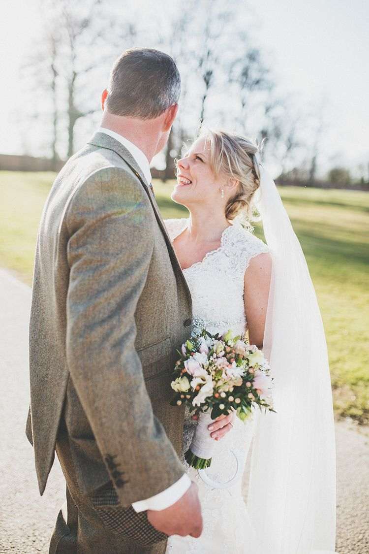 Pretty spring country wedding with rustic touches and a romantic lace wedding dress by Maggie Sottero.