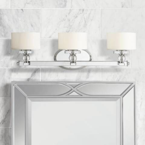 a sparkling bathroom wall fixture from quoizel's downtown
