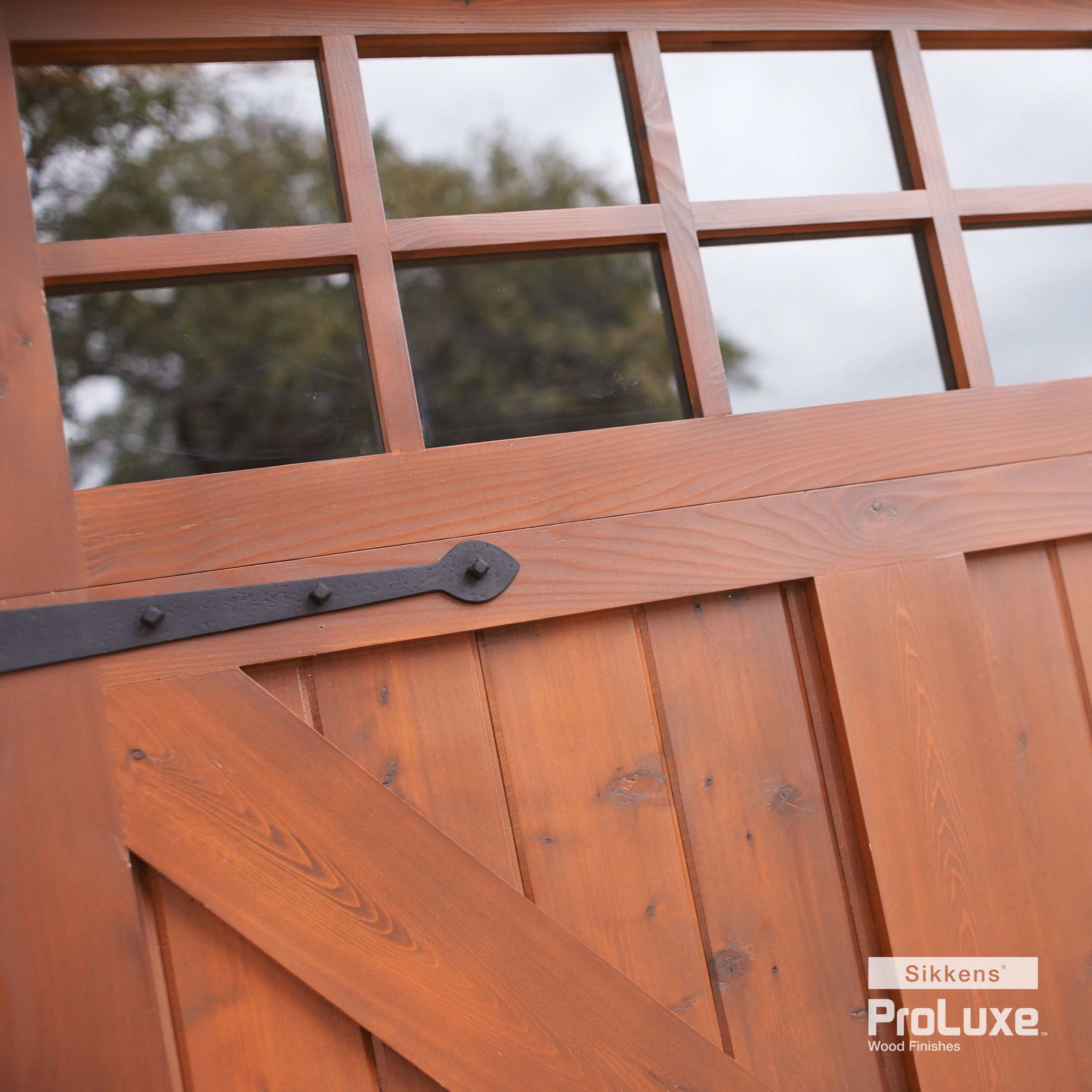 Close Up Of A Chic, Farmhouse Style Garage Door Featuring SIKKENS® PROLUXE