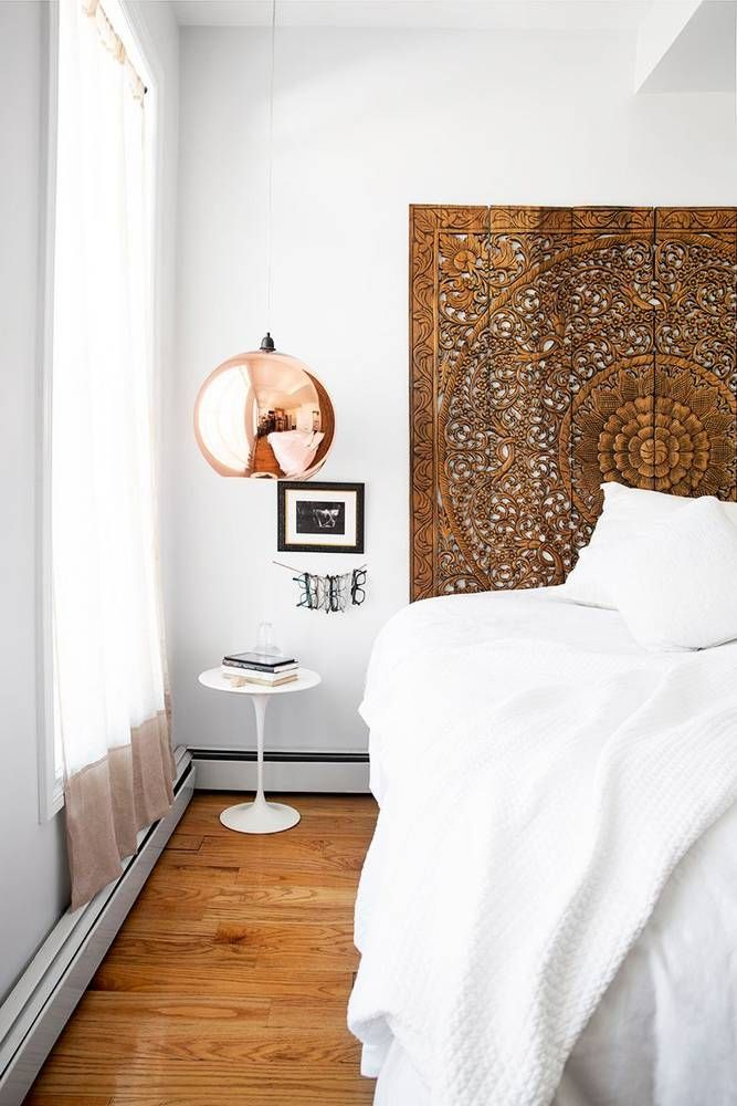 894d7fb4d5f Bedroom with a bohemian inspired headboard and a rose gold pendant light
