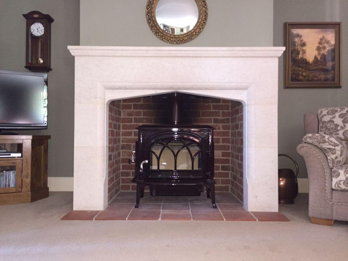 jotul f500 in majolica brown enamel in stone fireplace jotul